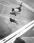 Chinook helicopter hauls a rocket launcher over the autobahn, 1979
